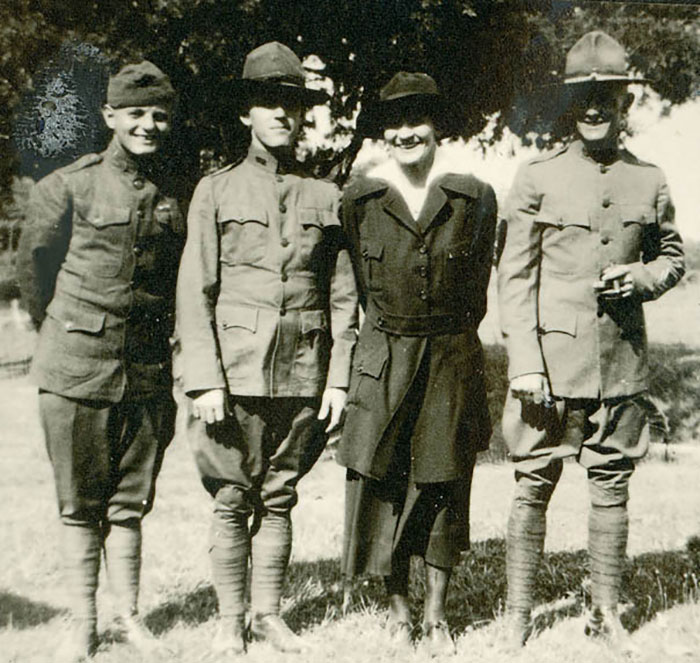 Linnie Leckrone standing with her brothers